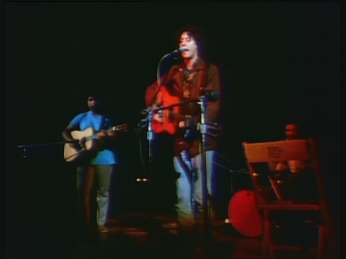 Arlo and his band onstage at the Woodstock Festival.