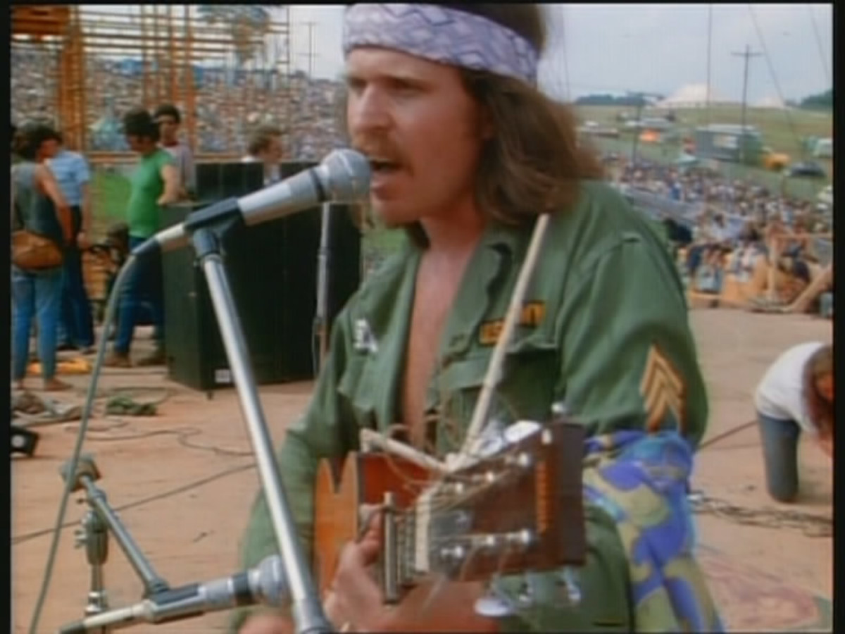 Country Joe McDonald onstage at Woodstock