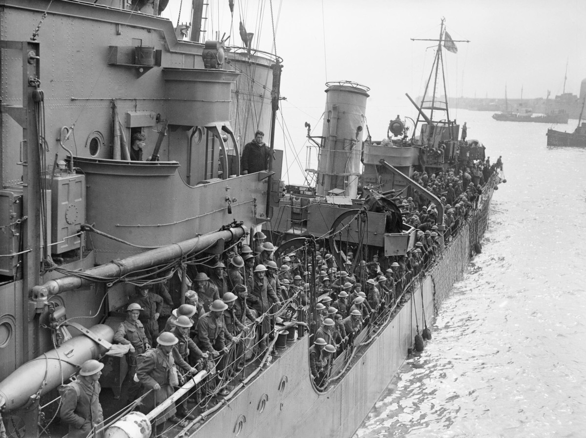 Troops evacuated from Dunkirk on a destroyer about to berth at Dover, 31 May 1940