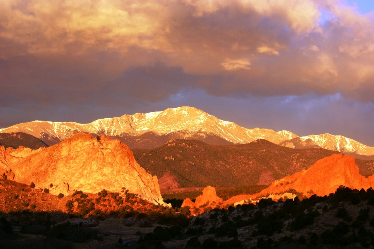 Garden of the Gods in Colorado Springs, CO with Pikes Peak towering above it.