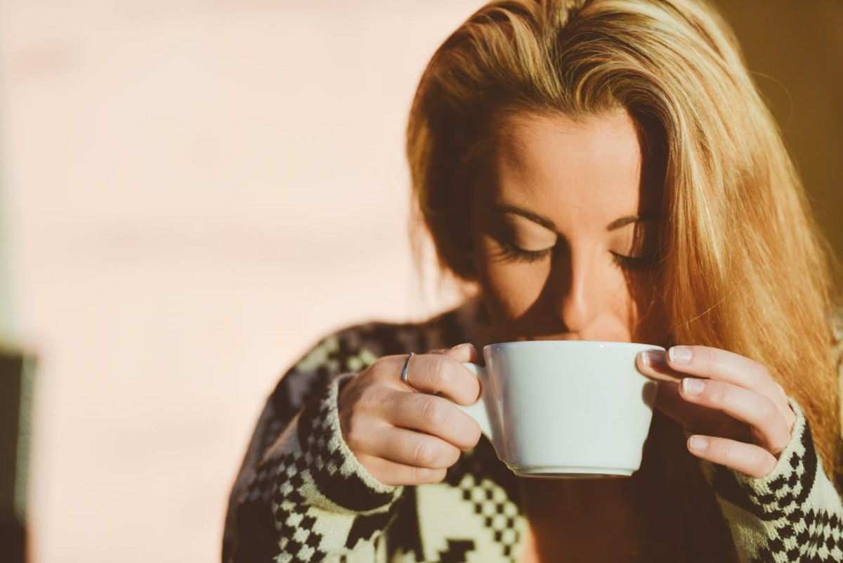 This is NOT me in disguise. But notice what this model is doing:enjoying black coffee, MY favorite taste.