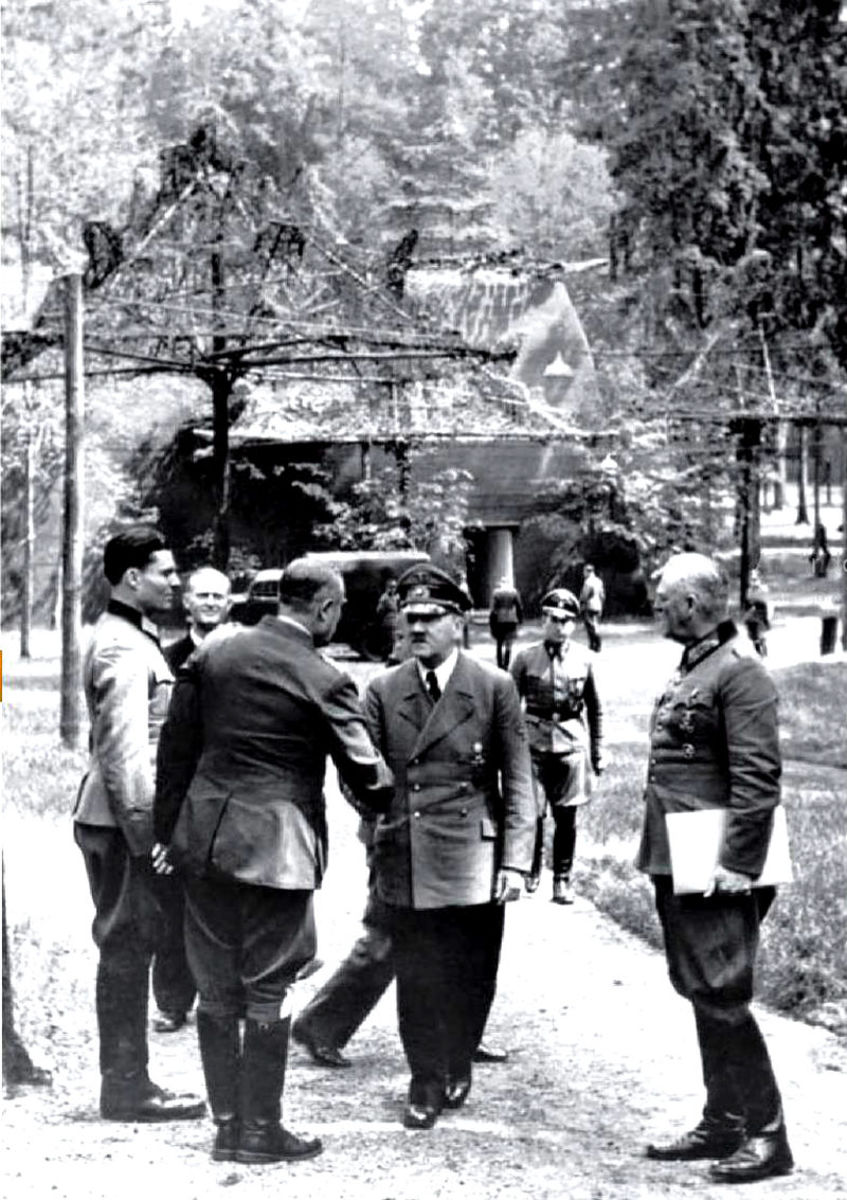 Claus von Stauffenberg (Left) alongside Adolf Hitler (Middle) and various Nazi officers. This photo was taken only a few minutes before Operation Valkyrie went into effect.