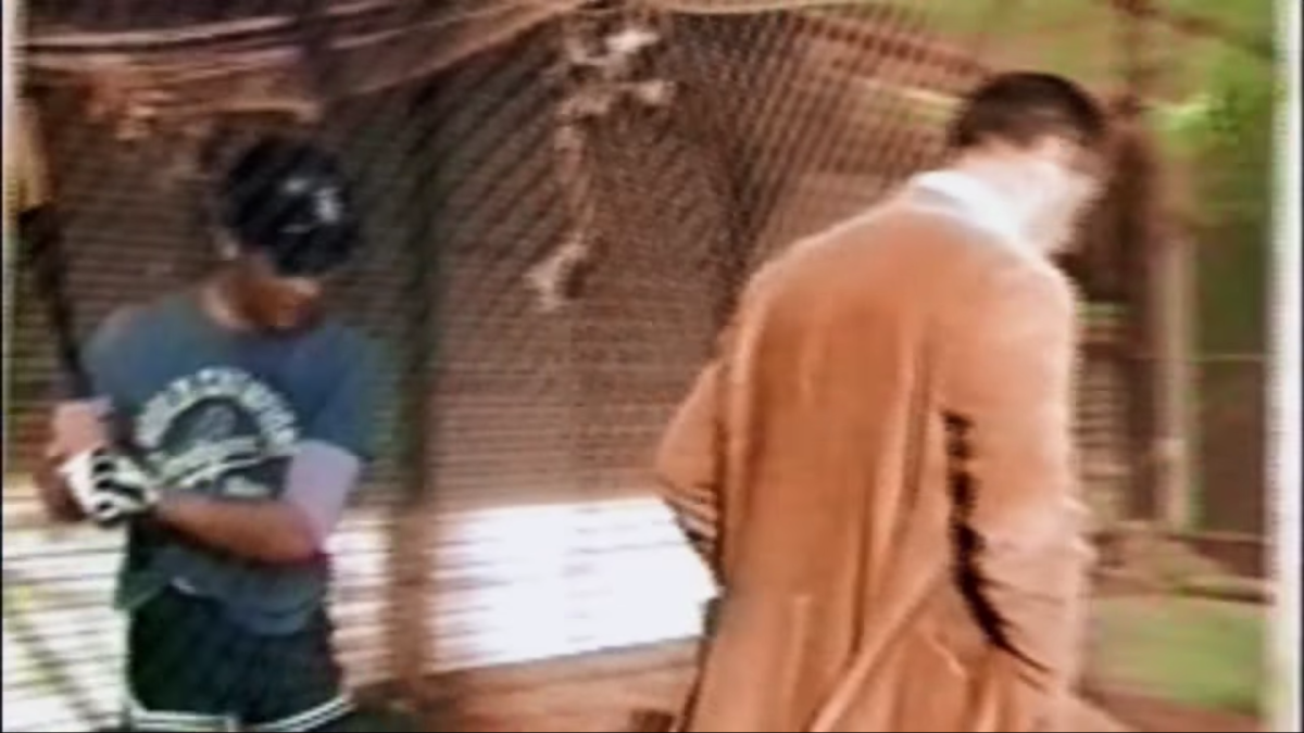 A young Mike Piazza (left) listens to Ted Williams give him hitting advice.