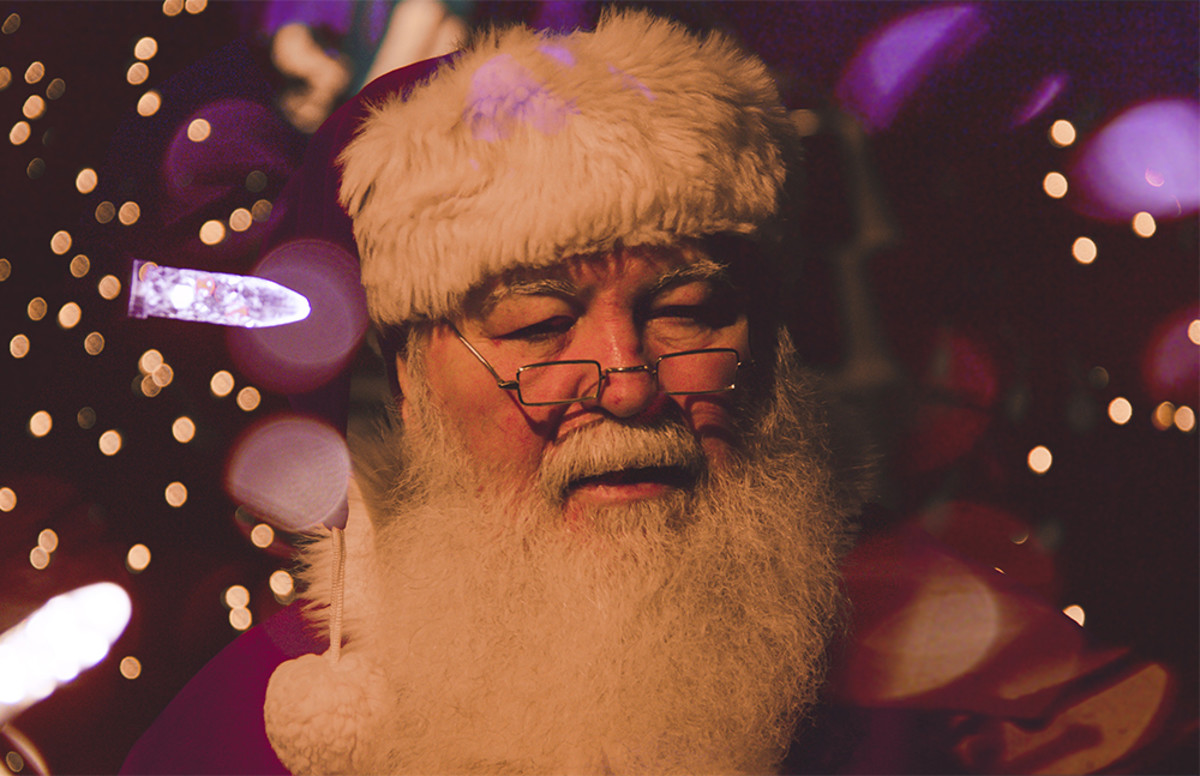 Our modern version of Santa is usually depicted with a long, white beard, glasses, and a pointy hat.