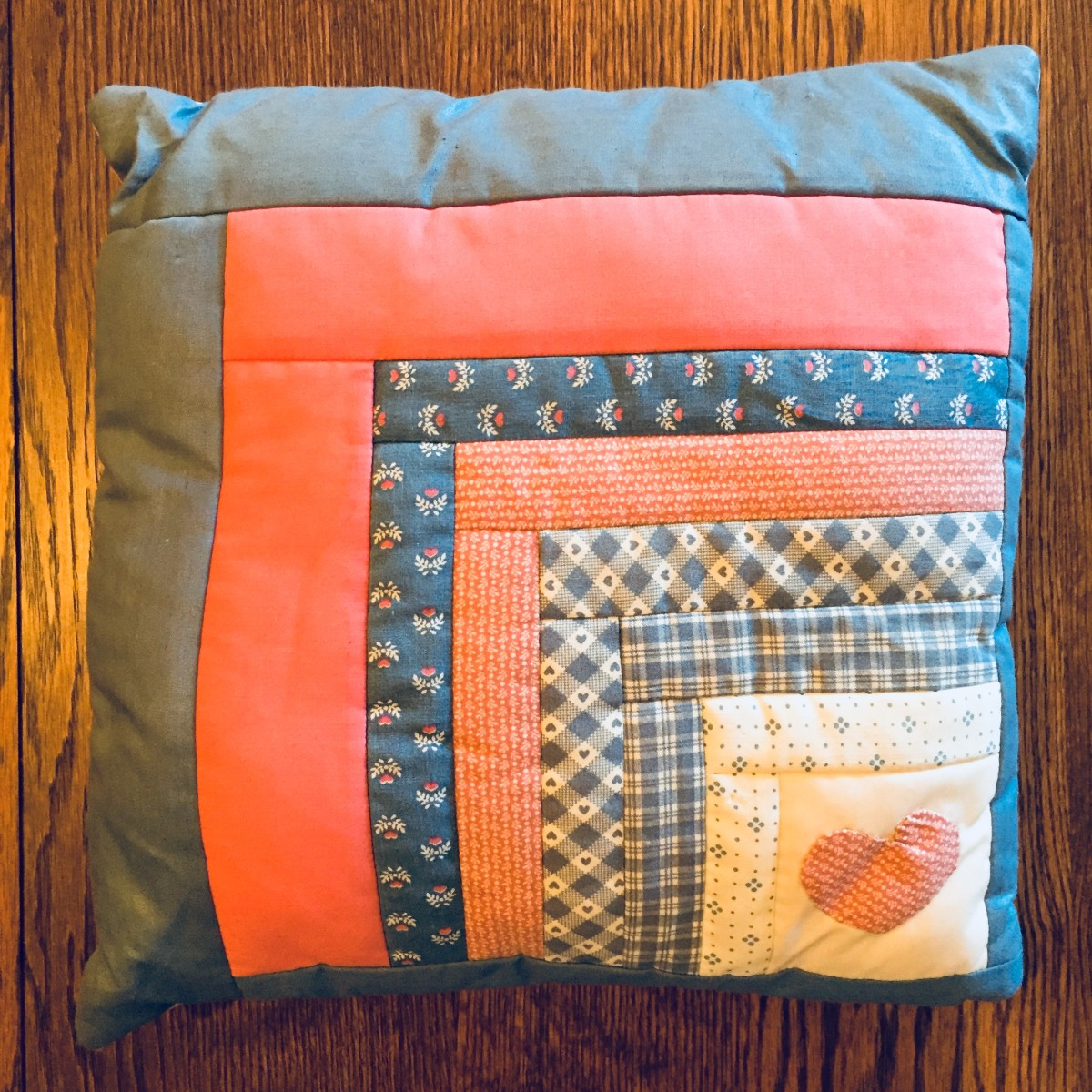 "This pillow is 12"" x 12"" - yours can be larger. My ""logs"" range from 7/8"" to 2 1/4"" wide but all of your strips could be the same width. My starting square is 3"" x 3"" placed in a corner. Your square could be larger, or placed in the center, or both!."