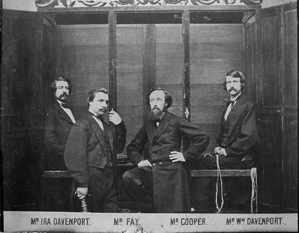 The Davenport Brothers and their famous cabinet.