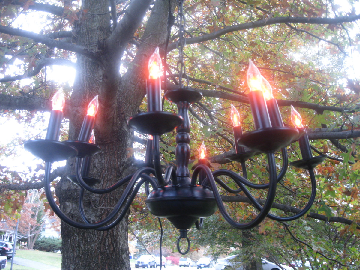 The finished Halloween chandelier hanging in a tree