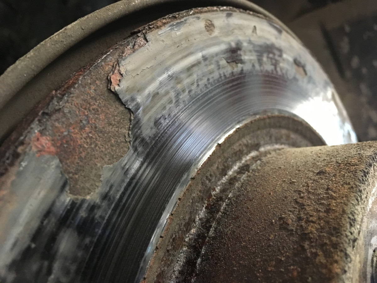 The brake rotor in this picture is rusted to the point that the metal is starting to flake off. Every time the customer would apply the brakes it would make a thumping noise.