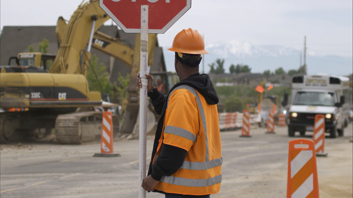 State Or Construction Employees Keep Traffic Flowing.