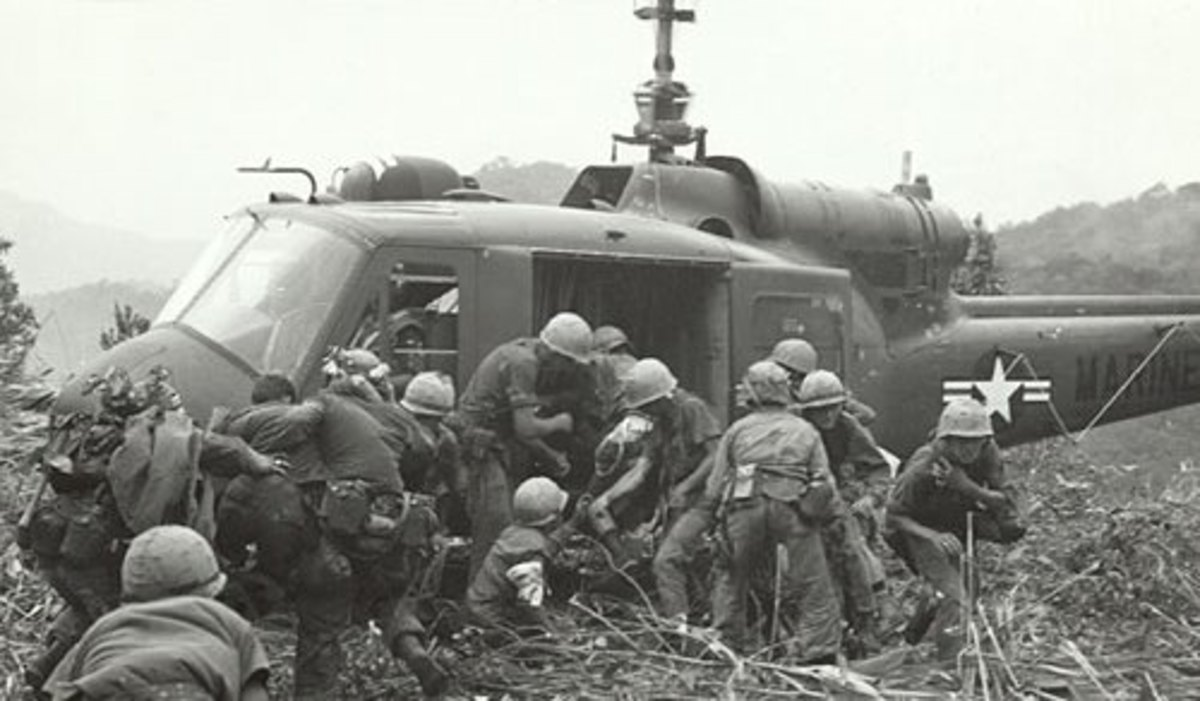 Wounded Marines being loaded for medivac near Mutter's Ridge.