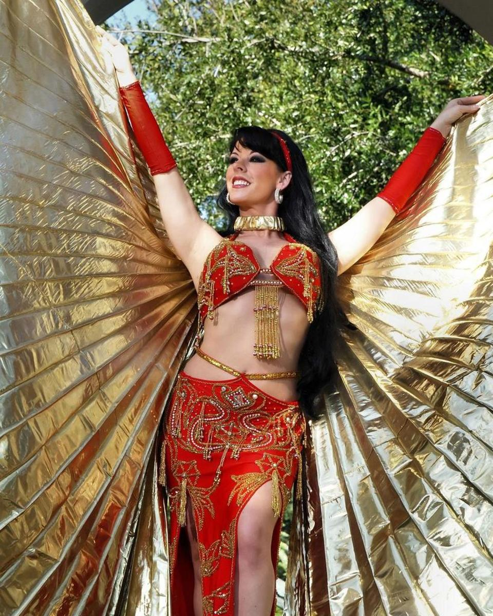 Professional belly dancing performer dancing with Isis Wings.