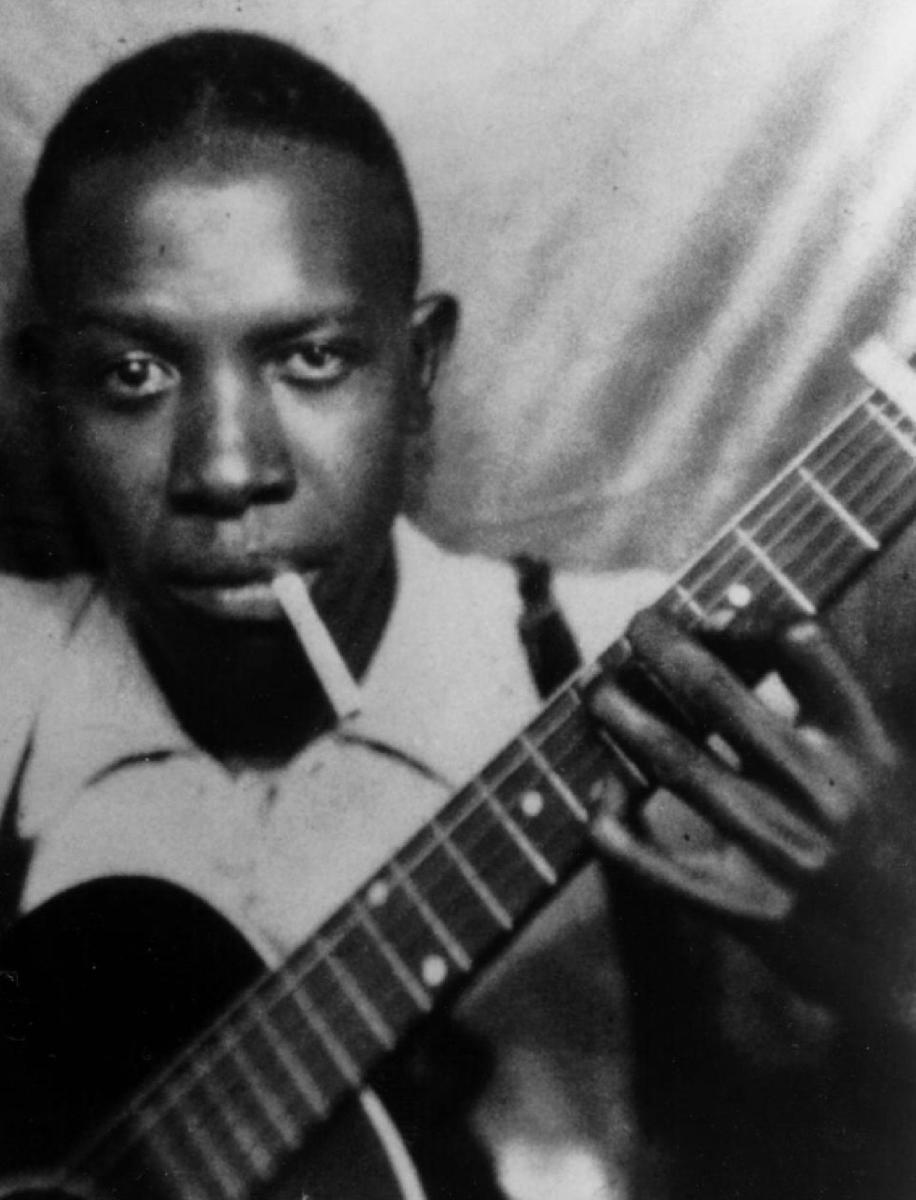Robert Johnson and what is believed to be a Gibson Kalamazoo KG-14
