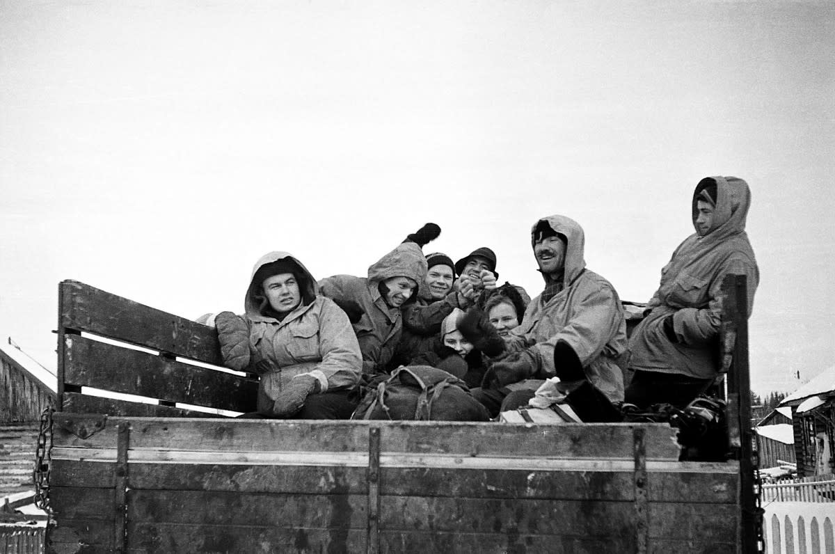 Group photo of 8 out of 9 hikers in the back  of a truck