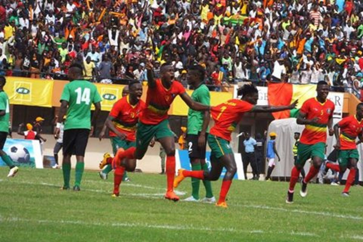 Guinea-Bissau player (red) celebrates during a 2017 Africa Cup of Nations qualifier against Zambia in Bissau on June 4, 2016. This victory, coupled with another result, secured a spot at the 2017 African Cup of Nations.