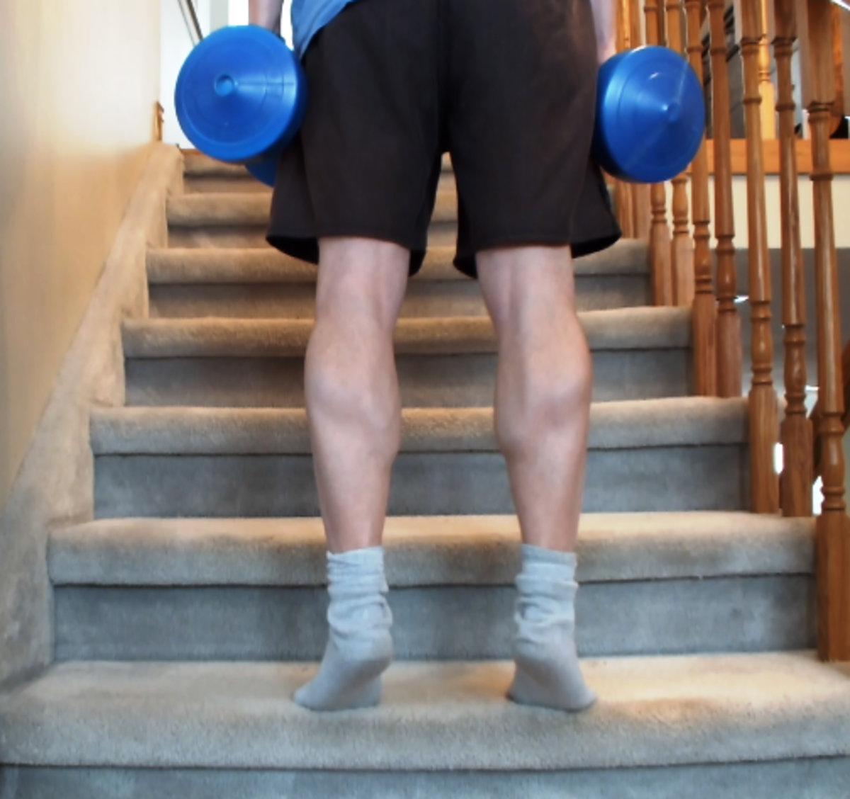 Doing calf raises on the stairs
