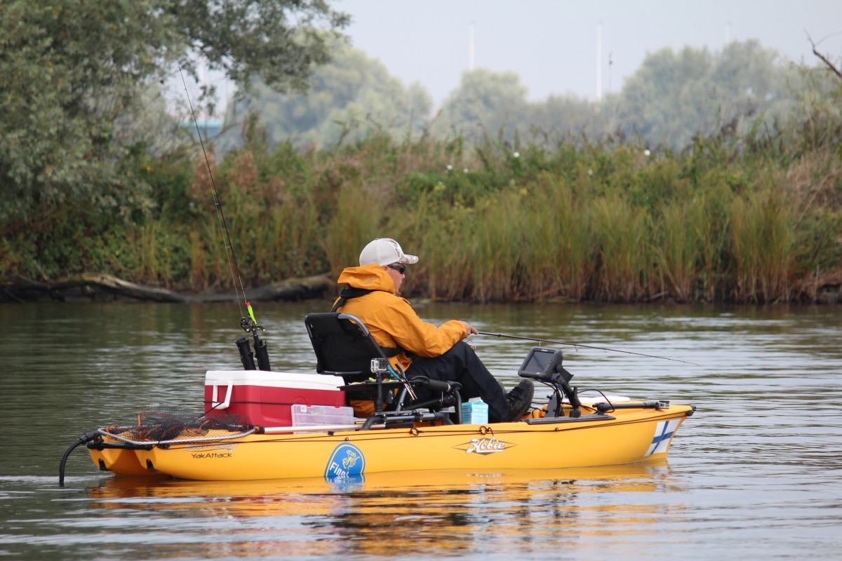 Fisherman in sit-on-top Hobie kayak.
