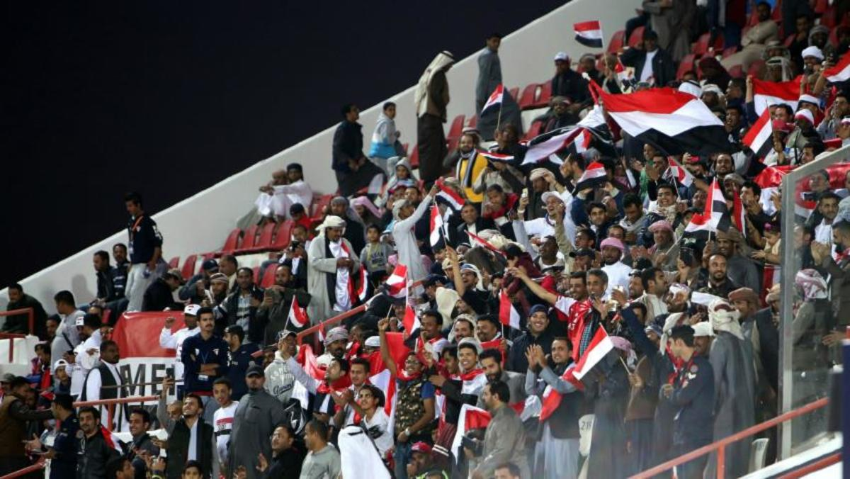 In Doha, Qatar, fans inside Suheim bin Hamad Stadium celebrate during a 2019 Asian Cup qualifier between Yemen and Nepal on Mar. 27, 2018. Yemen won the match 2-1 to secure its first Asian Cup as a unified nation.