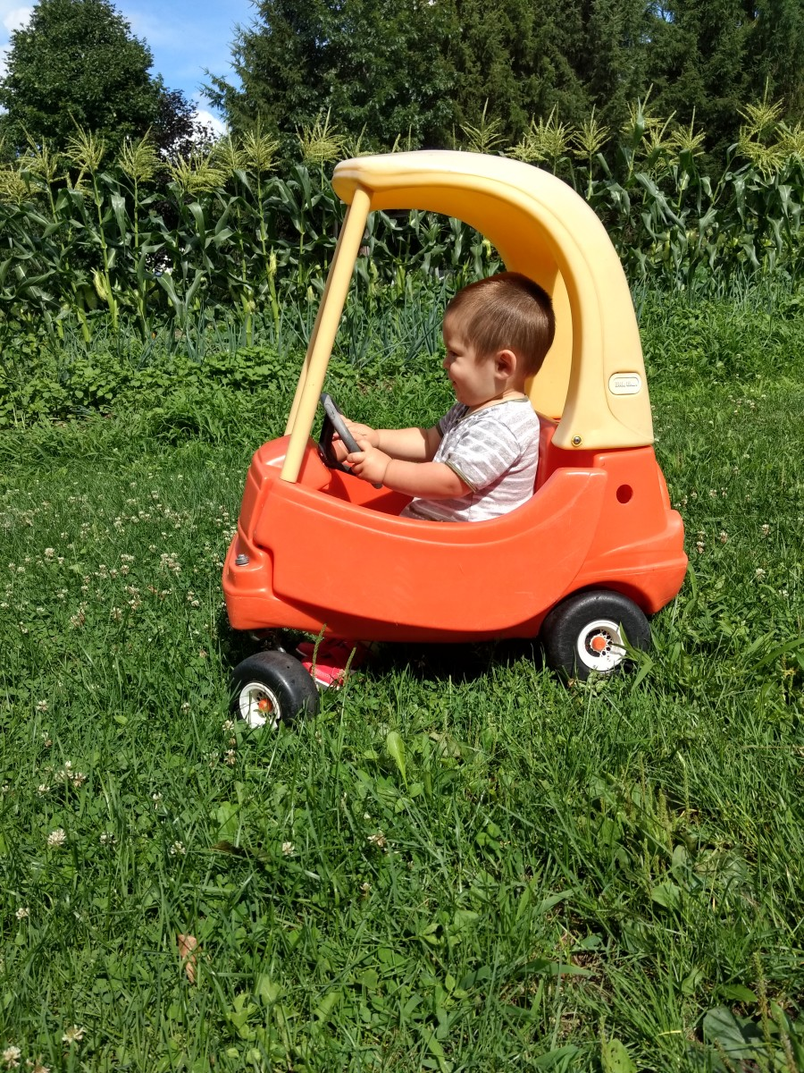 A cozy coupe I found for $2 at a garage sale, has entertained my son for hours at a time!