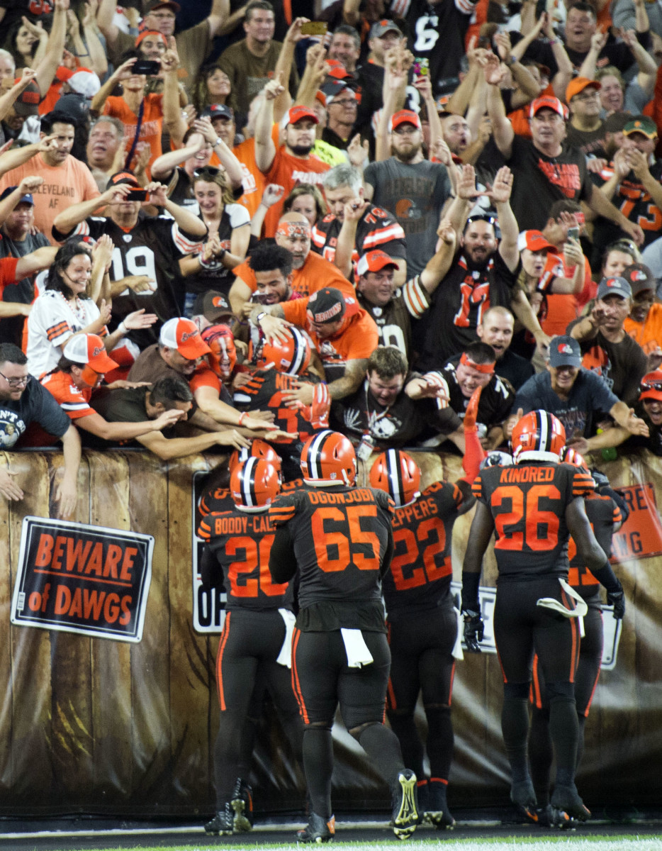 Members of the Cleveland Browns celebrate with fans after they beat the New York Jets at FirstEnergy Stadium to snap a 19-game winless streak.