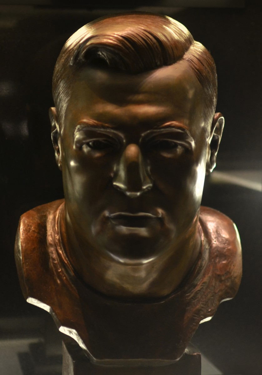 Mike McCormack's bust as seen in the Pro Football Hall of Fame.