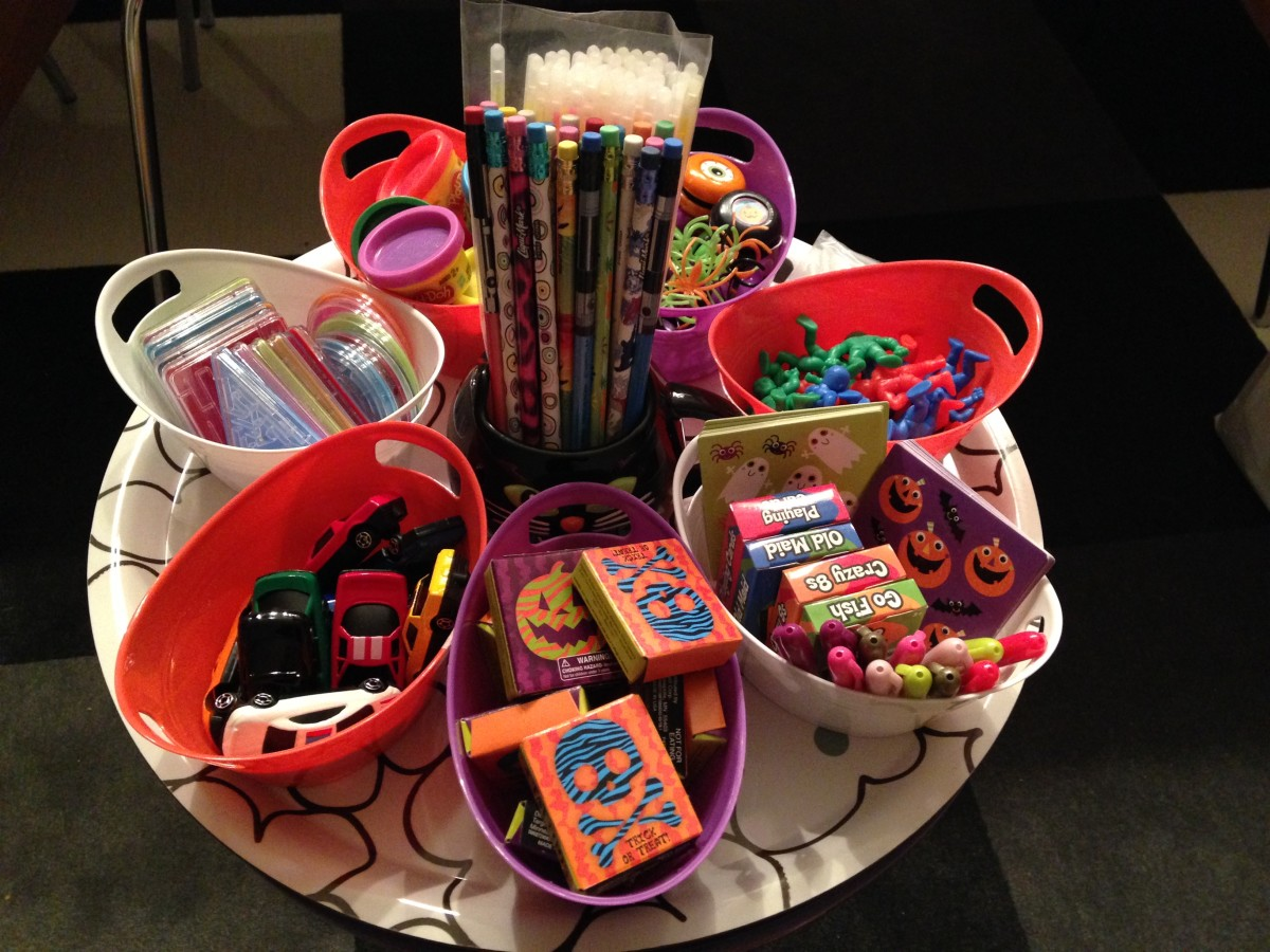 I keep non-candy treats in bins so that trick-or-treaters can pick several items.