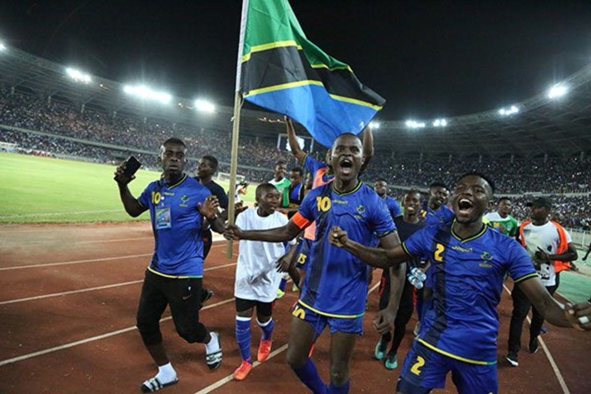 Tanzanian players and fans celebrate inside the National Main Stadium in Dar Es Salaam on Mar. 24, 2019. Tanzania defeated Uganda 3-0 to clinch only its second Africa Cup of Nations berth, but first since 1980.