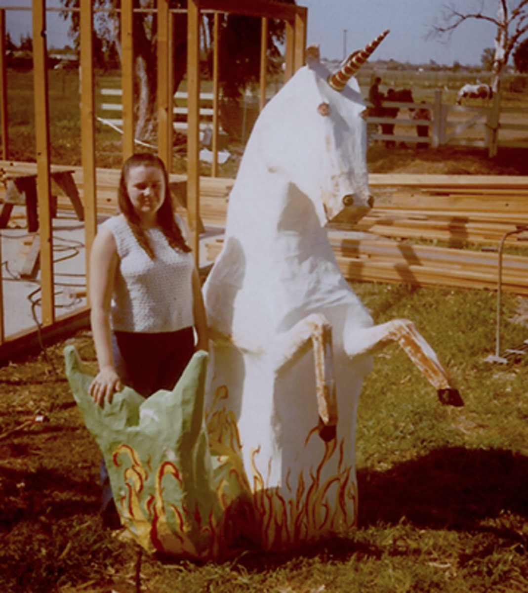 This is me in 1971 with my sculpture of a paper mache mer-unicorn.