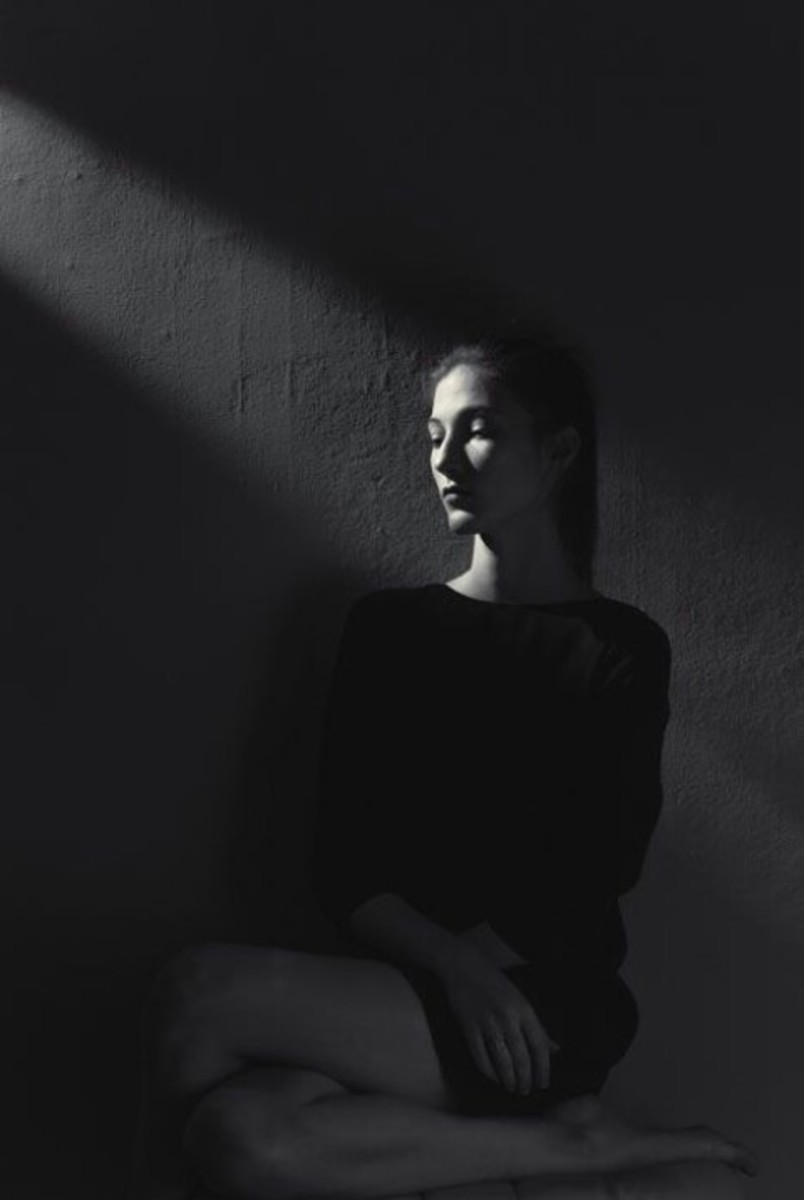 A woman caressed by the darkness