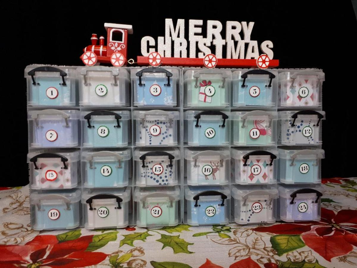 This is the DIY advent calendar I put together using supplies from Michaels and the Dollar Store.