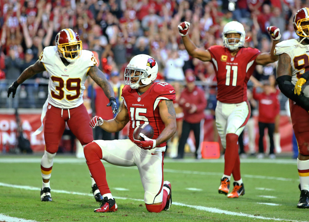 Arizona Cardinals receivers, Michael Floyd (15) and Larry Fitzgerald (11), celebrate after Floyd scored against the Washington Redskins in 2016. Both are among the 13 players in Cardinals' history to catch more than 1,000 receiving yards in a season.