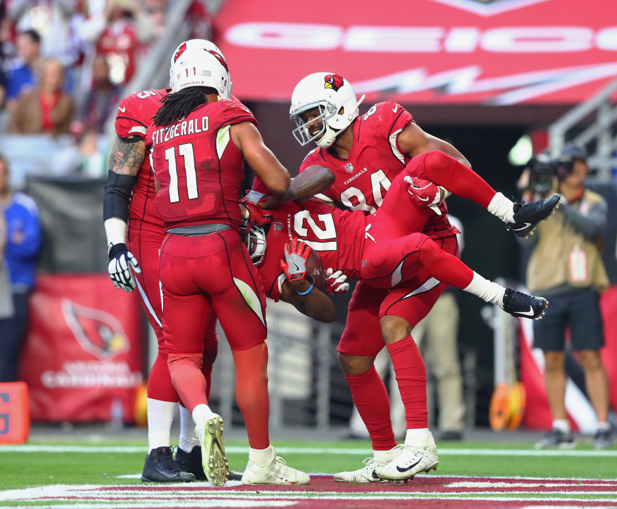 Arizona Cardinals wide receiver, John Brown (12), is lifted by tight end Jermaine Gresham (84) as he celebrates a third quarter touchdown with Larry Fitzgerald (11) against the New York Giants.