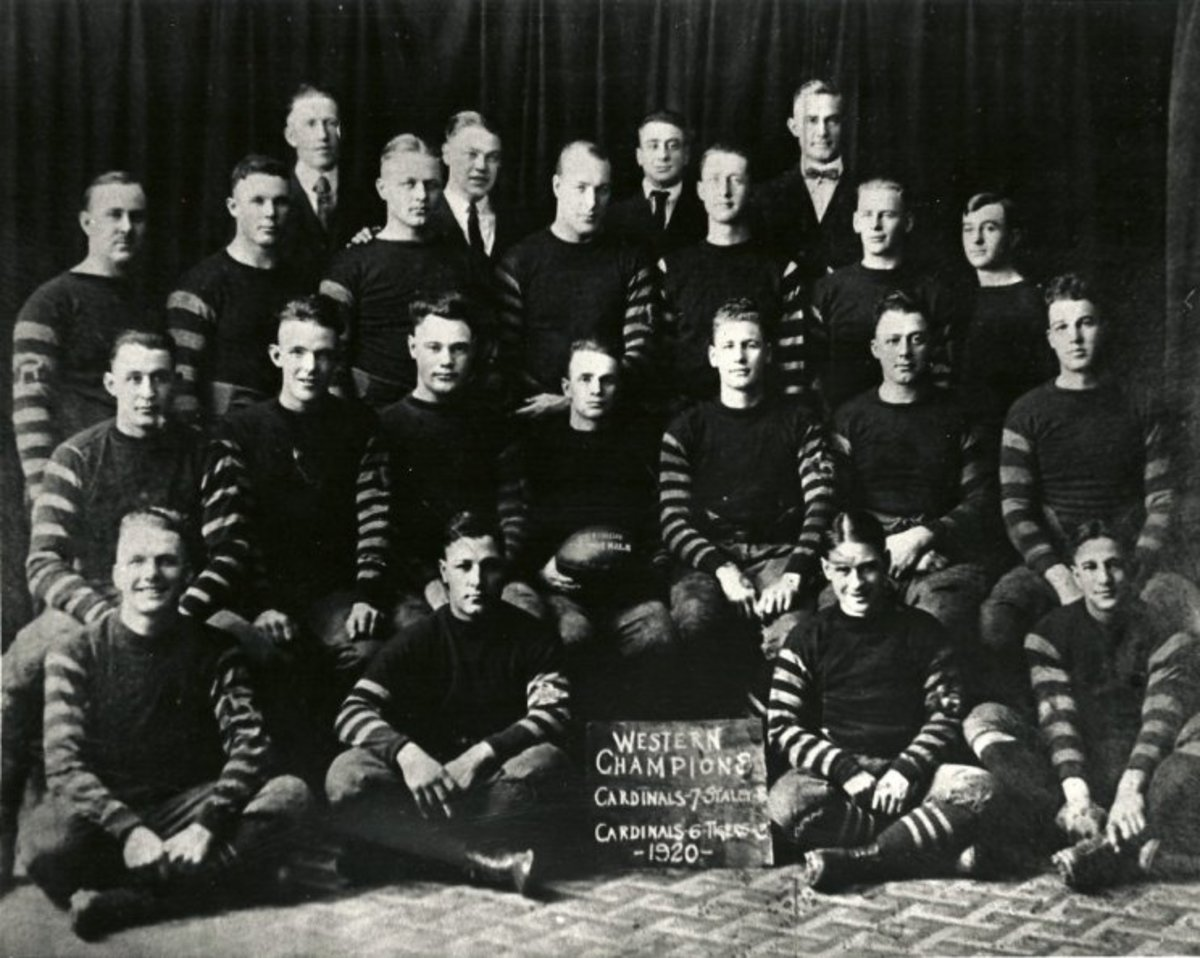 Paddy Driscoll holds the the football with his teammates on the 1920 Chicago Cardinals, the first team in franchise history.