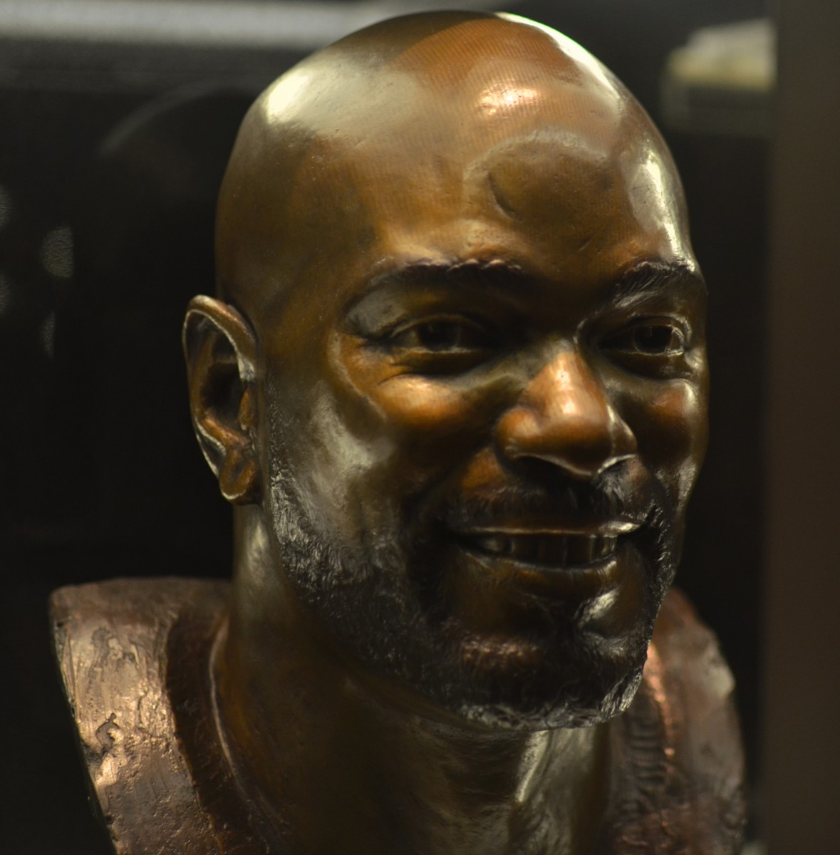Emmitt Smith's bust as seen in the Pro Football Hall of Fame in Canton, Ohio. Though he played the majority of career with the Dallas Cowboys, he closed out his playing days with two seasons for the Arizona Cardinals.
