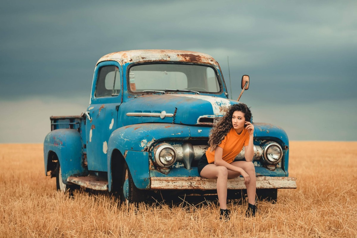 This truck is a 1955 Ford, not Chevy. I do not know what year this girl was made.