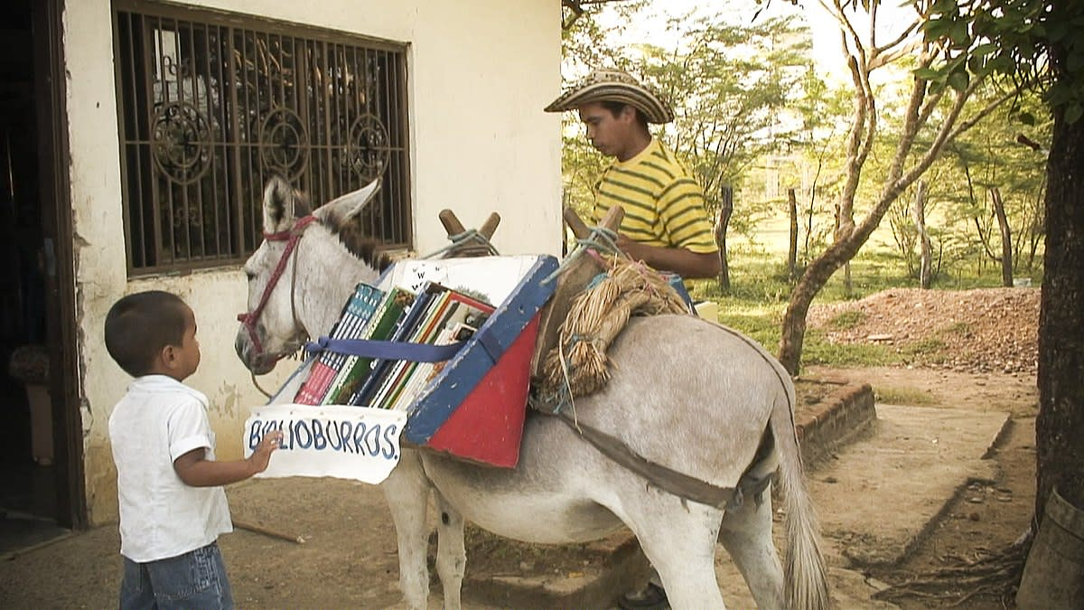 Luis Soriano (in hat) with his donkey library.