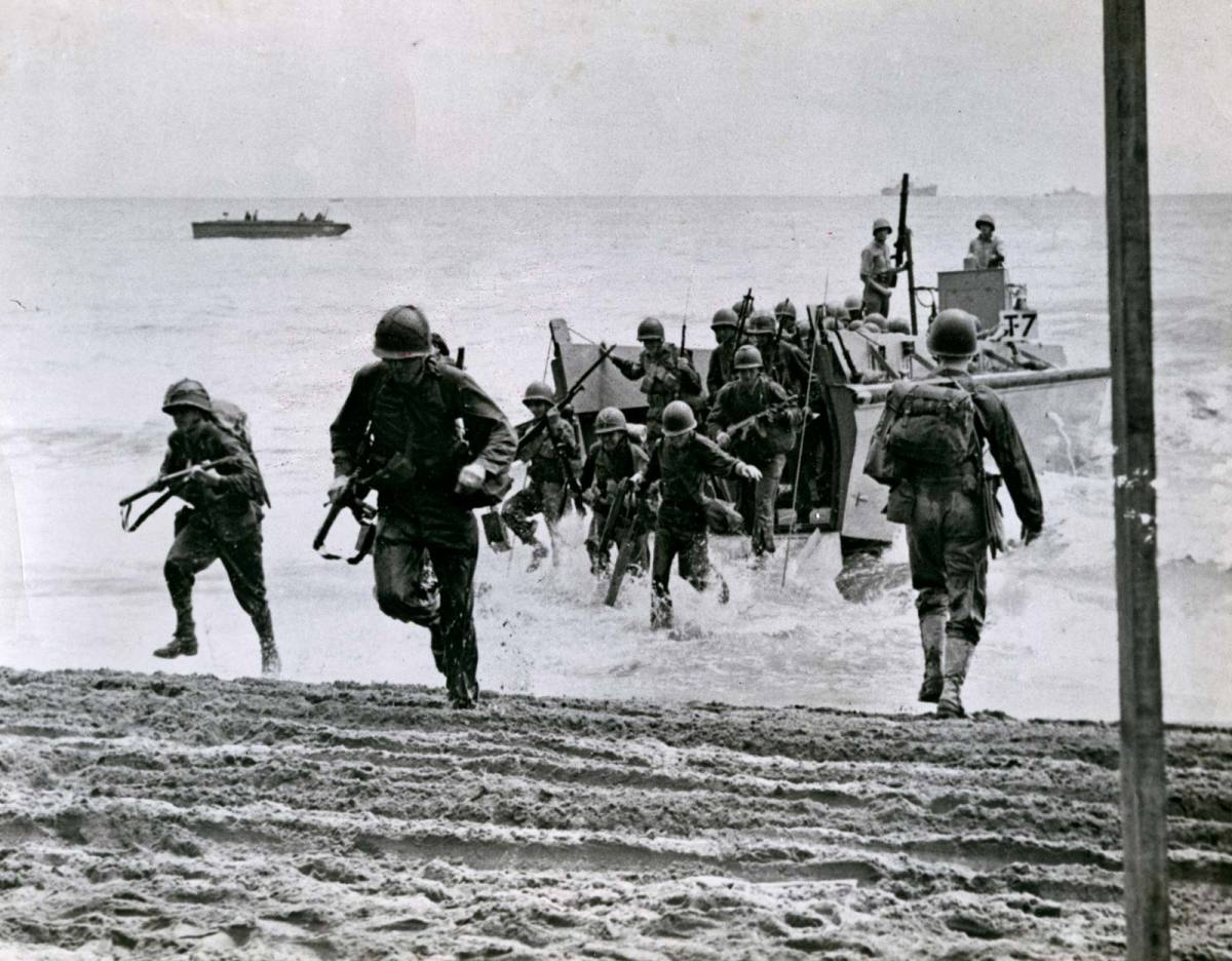 U.S. Marines invade the small island of Guadalcanal (7 August 1942).
