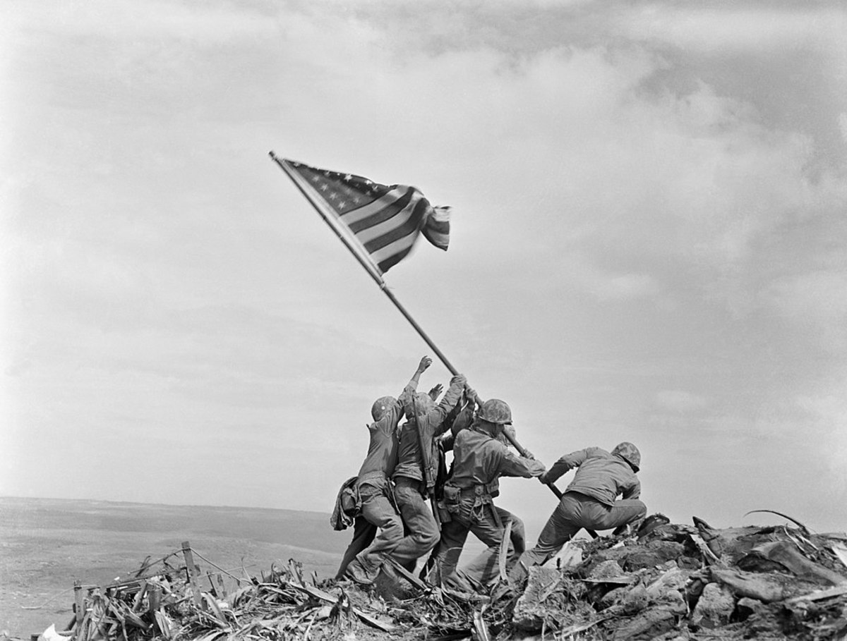 Marines raising the American Flag over Iwo Jima.
