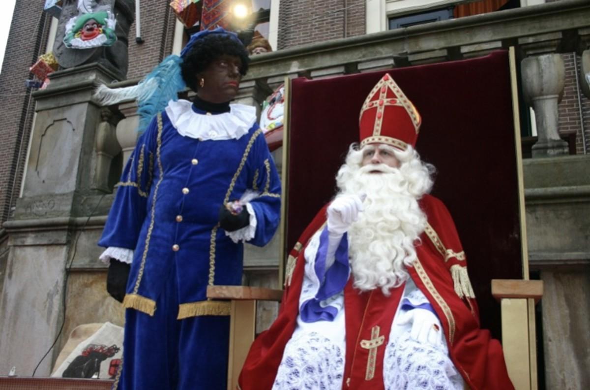 Sinterklaas and Zwarte Piet arrive to greet the revelers.