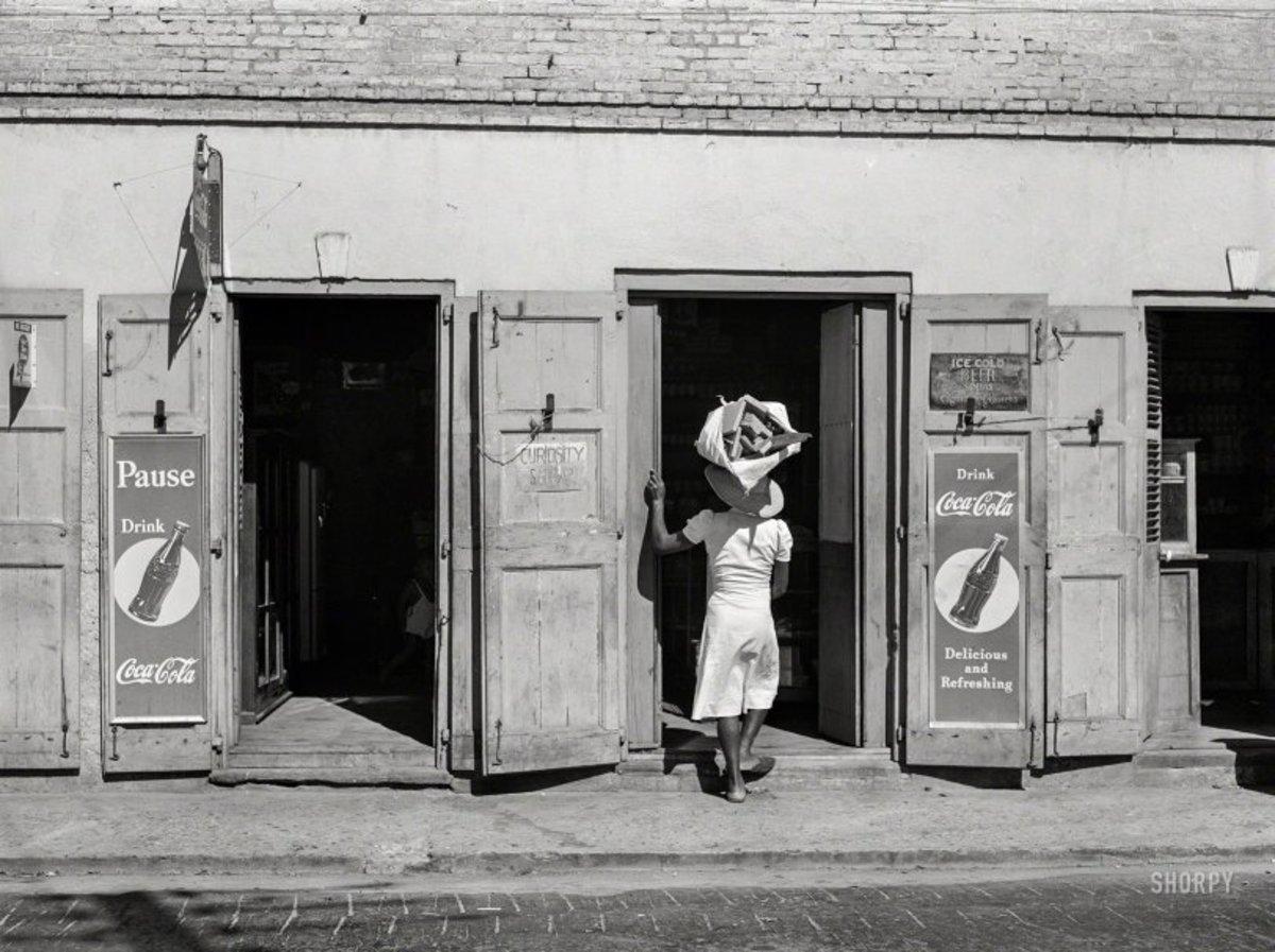 "December 1941. ""Charlotte Amalie, Saint Thomas, Virgin Islands. Along the main street."" Medium format negative by Jack Delano."