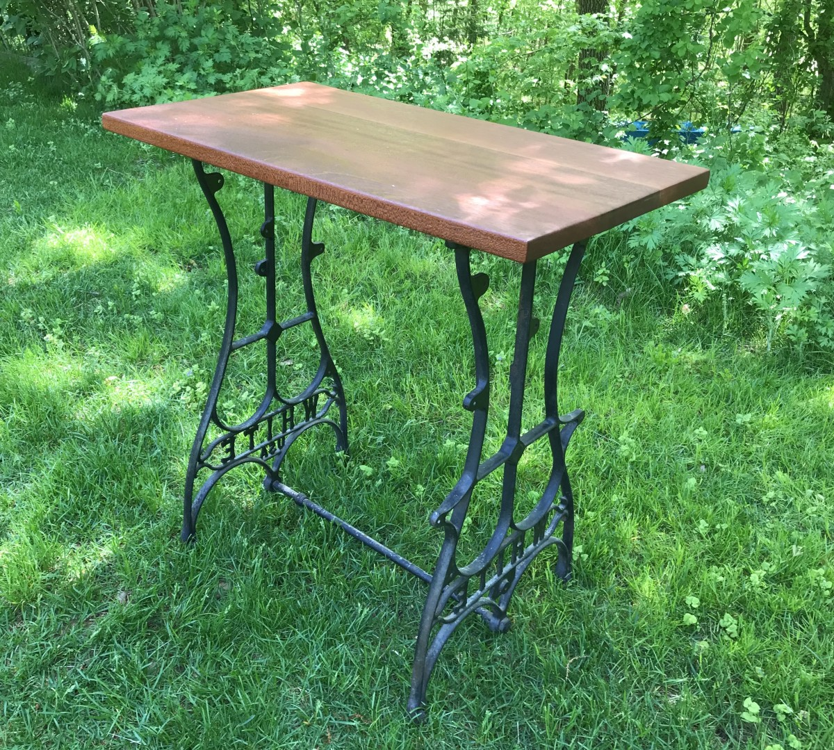 Turn a vintage sewing machine stand into an interesting and useful table.