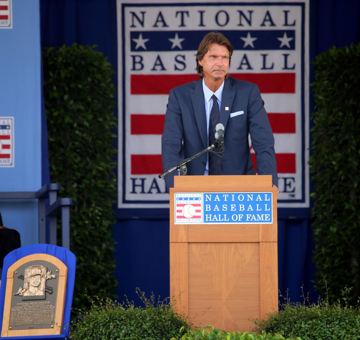 Former Arizona Diamondbacks pitcher Randy Johnson delivers a speech at his 2015 Hall of Fame induction. He is the only Arizona player to wear a Diamondbacks cap on a Hall of Fame plaque.