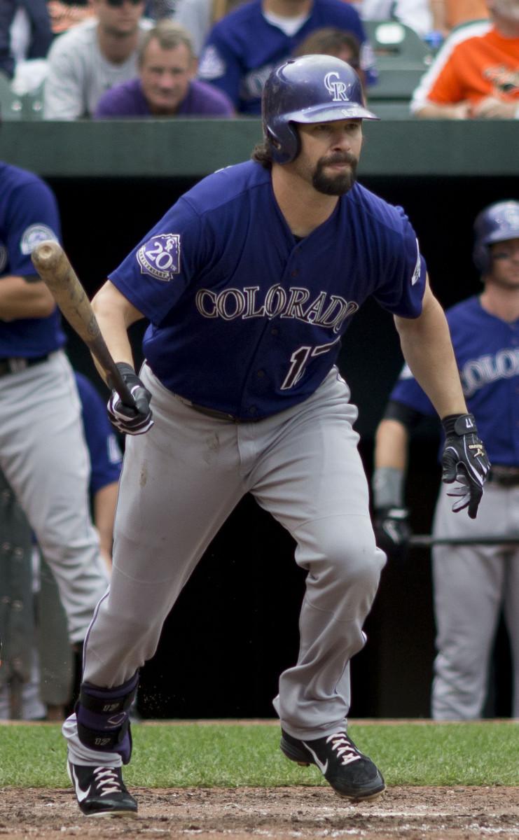 Former Colorado Rockies first baseman Todd Helton runs to first base during a game in 2013. Helton holds a handful of franchise records after he spent all 17 years of his career with the Rockies.