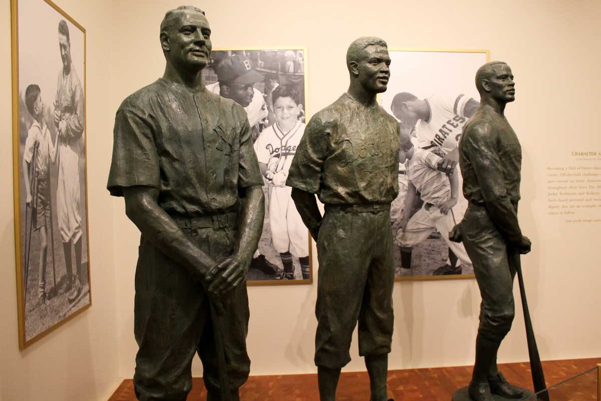 A display depicting statues of Lou Gehrig (left), Jackie Robinson (center) and Roberto Clemente (right) was on display at the Baseball Hall of Fame in Cooperstown, New York, in 2014.