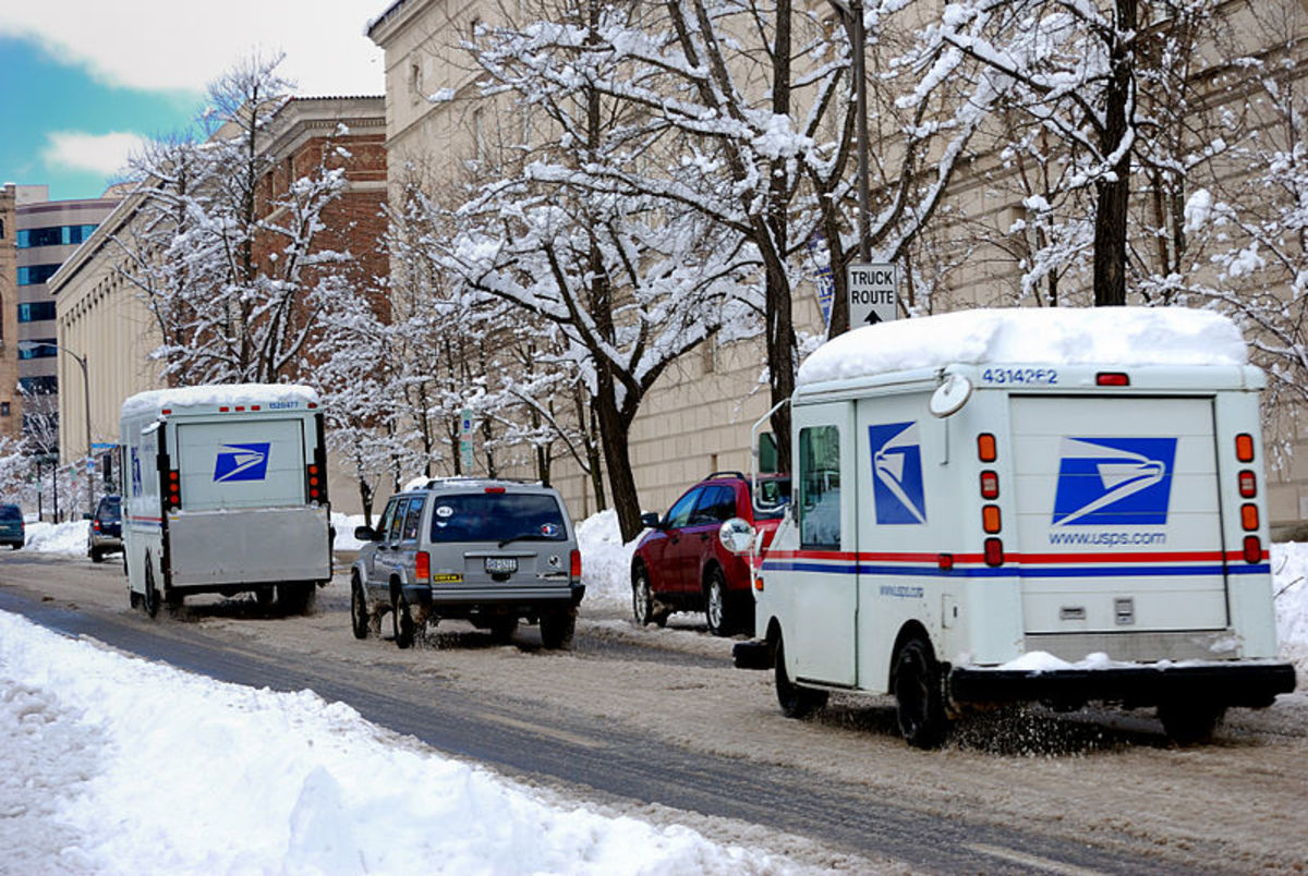 The Postal Service slogs ahead, through the snow, sleet, mud, sometimes smoke, into the New Year 2020.