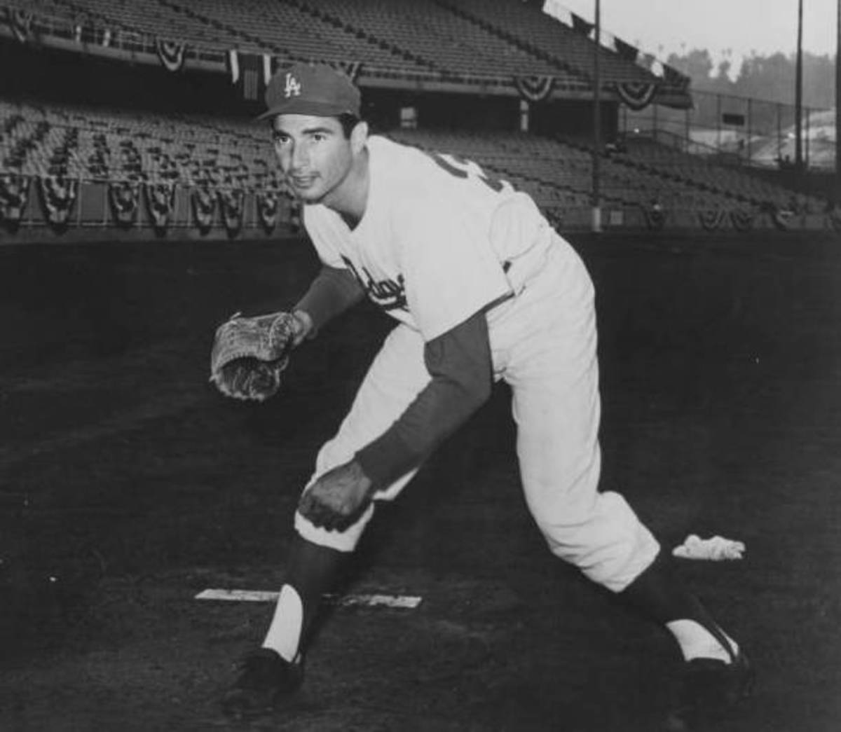 A young Sandy Koufax poses for a photo early in his career with the Los Angeles Dodgers. Despite an early retirement that left him with only a 12-year career, Koufax is regarded as one of the greatest left-handed pitchers in baseball history.