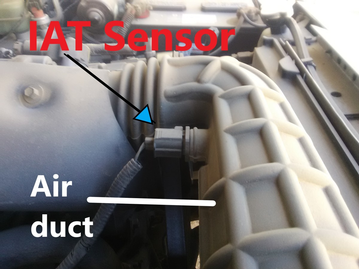 An IAT sensor located on the air duct of a Ford Explorer.