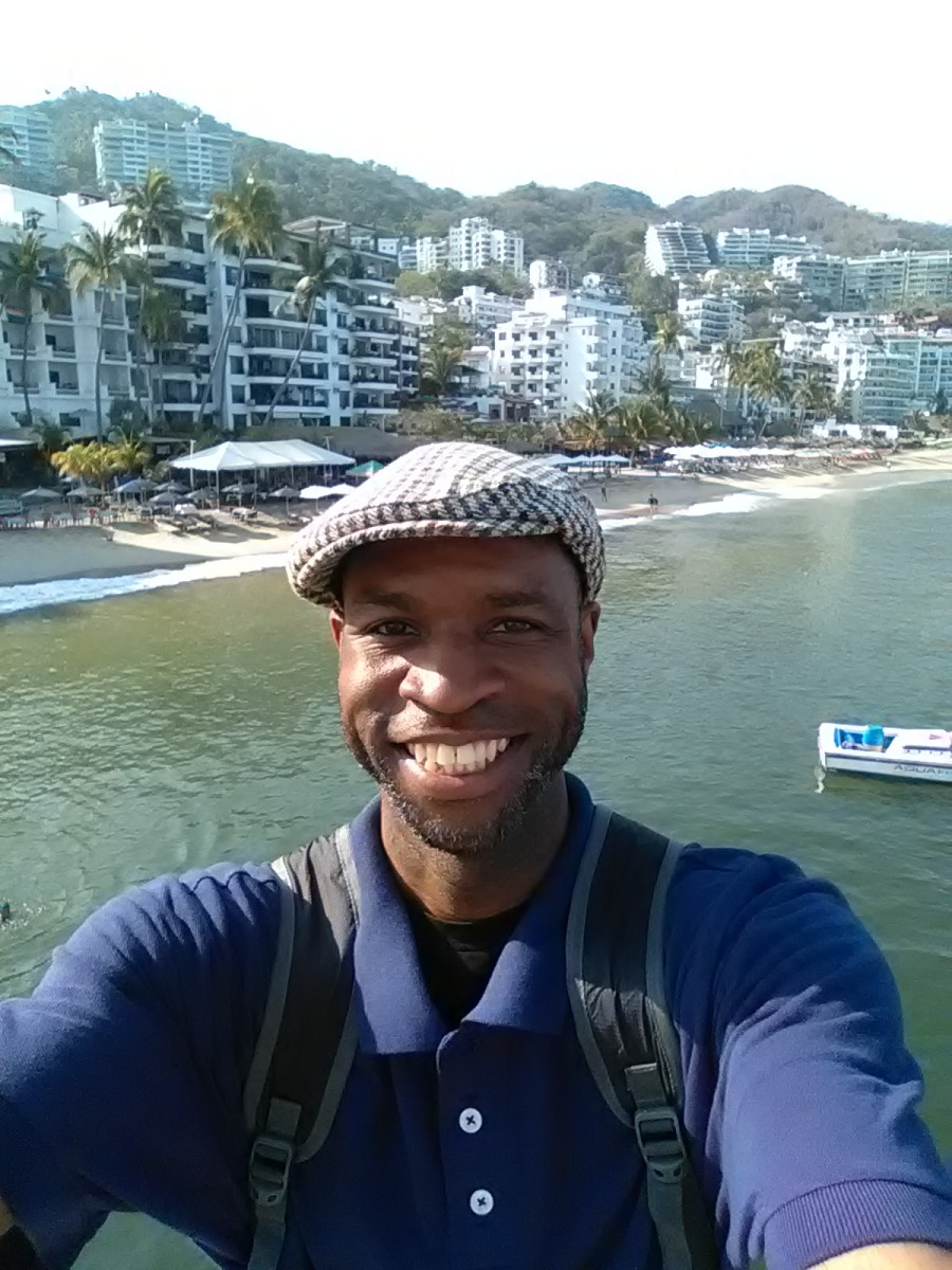 My online revenue streams allow me to be able to travel the world. Here I'm enjoying the sun and sand in Puerto Vallarta, Mexico