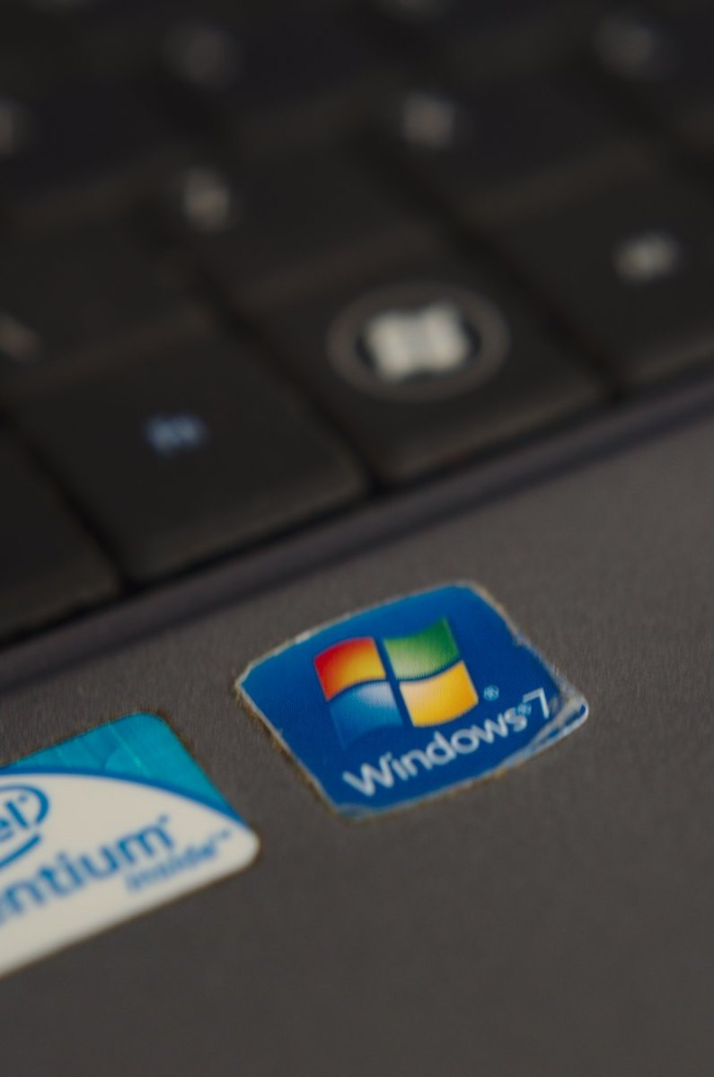 Windows 7 sticker on a laptop computer