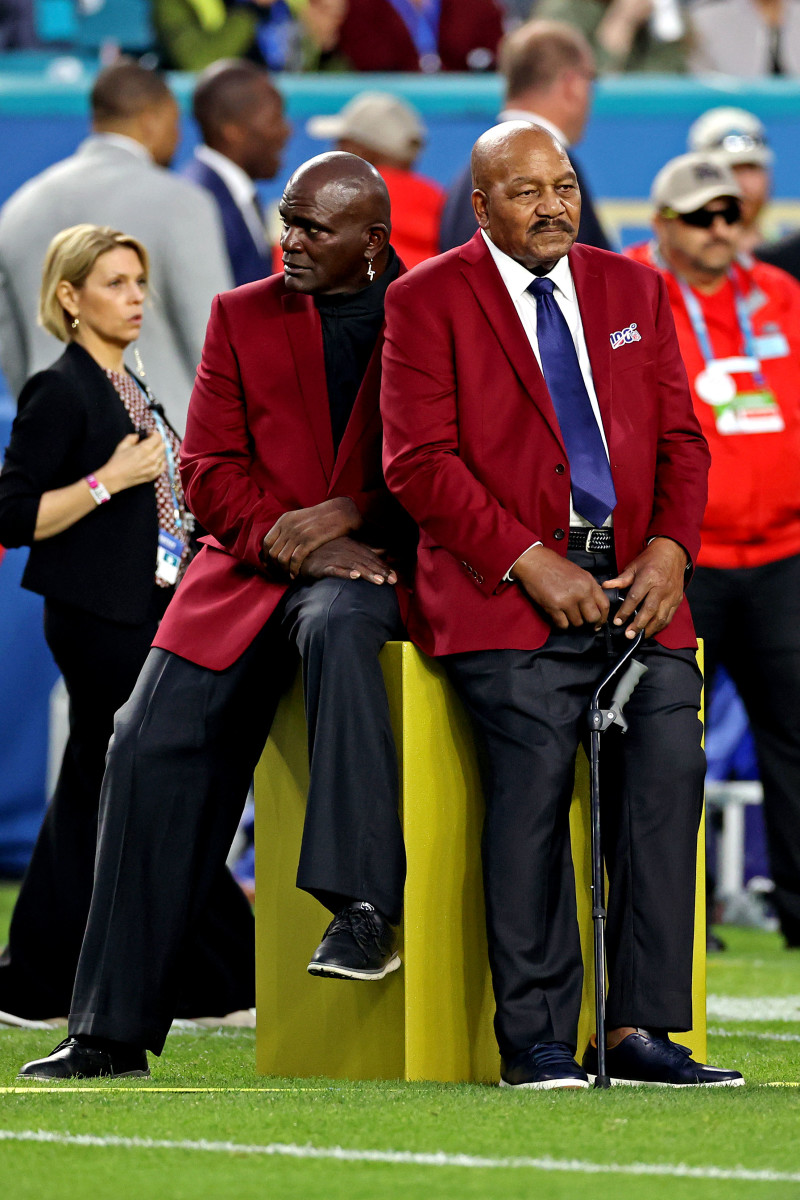 NFL 100 All-Time Team members Lawrence Taylor (left) and Jim Brown before Super Bowl LIV between the San Francisco 49ers and the Kansas City Chiefs at Hard Rock Stadium, Feb. 2, 2020