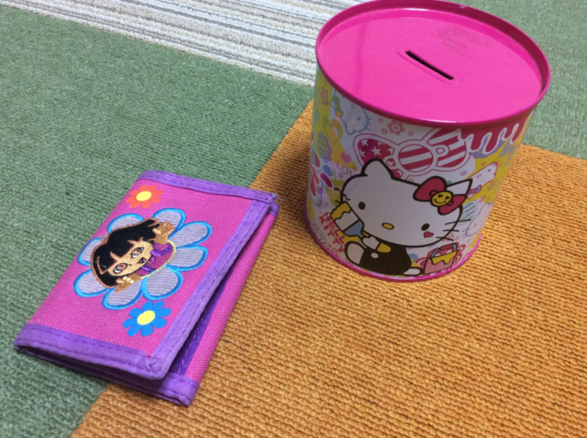 A child's wallet and piggy bank.